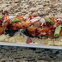 ALABAMA BBQ SHRIMP WITH GRITS, SPINACH  AND ANDOUILLE BUTTER SAUCE